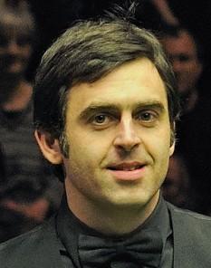 """Ronald Antonio """"Ronnie"""" O'Sullivan (n. 5 decembrie 1975), jucător profesionist de snooker. Poreclele lui sunt """"Racheta"""", datorită faptului că lovește bilele cu mare viteză și """"Magicianul"""" - foto:  ro.wikipedia.org"""