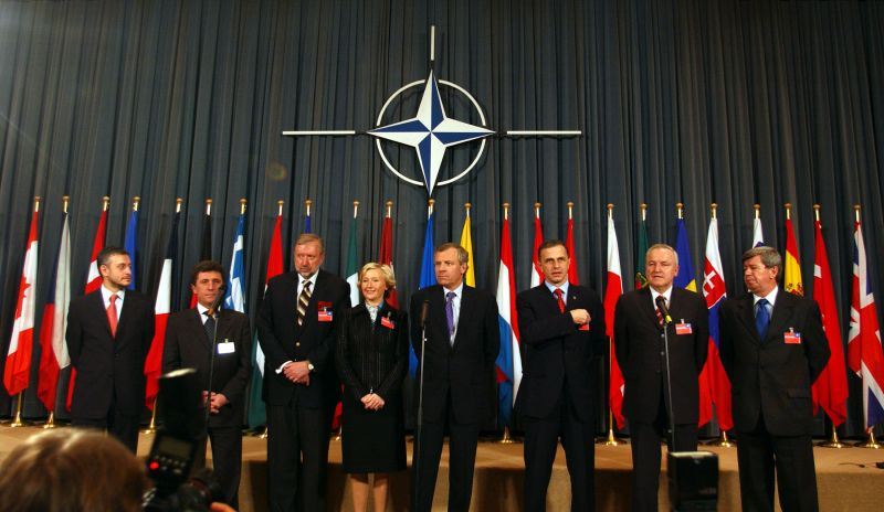 Accession Ceremony for the Seven New NATO Members - NATO Secretary General's joint news conference with Foreign Ministers of the seven new members (2 April 2004)  Solomon Passy, Minister of Foreign Affairs, Bulgaria Antanas Valionis, Minister of Foreign Affairs, Lithuania Dimitrij Rupel, Minister of Foreign Affairs, Slovenia  Kristiina Ojuland, Minister of Foreign Affairs, Estonia NATO Secretary General, Jaap de Hoop Scheffer Mircea Dan Geoana, Minister of Foreign Affairs, Romania  Rihards Piks, Minister of Foreign Affairs, Latvia Eduard Kukan, Minister of Foreign Affairs, Slovakia - foto credit nato.int