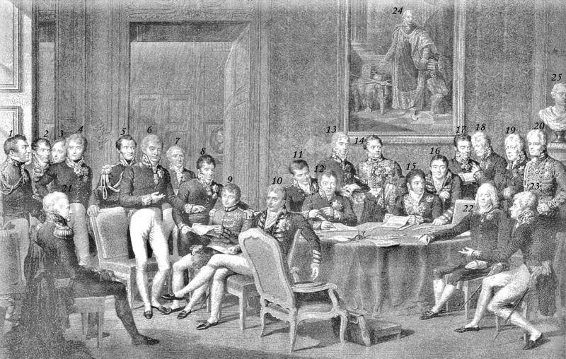 Delegaţii Congresului de la Viena, (18 septembrie 1814 - 9 iunie 1815) după o pictură a lui Jean-Baptiste Isabey ( 1. Arthur Wellesley 1. Arthur Wellesley, 1st Duke of Wellington 2. Joaquim Lobo Silveira, 7th Count of Oriola 3. António de Saldanha da Gama, Count of Porto Santo 4. Count Carl Löwenhielm 5. Jean-Louis-Paul-François, 5th Duke of Noailles 6. Klemens Wenzel, Prince von Metternich 7. André Dupin 8. Count Karl Robert Nesselrode 9. Pedro de Sousa Holstein, 1st Count of Palmela 10. Robert Stewart, Viscount Castlereagh 11. Emmerich Joseph, Duke of Dalberg 12. Baron Johann von Wessenberg 13. Prince Andrey Kirillovich Razumovsky 14. Charles Stewart, 1st Baron Stewart 15. Pedro Gómez Labrador, Marquis of Labrador 16. Richard Le Poer Trench, 2nd Earl of Clancarty 17. Wacken (Recorder) 18. Friedrich von Gentz (Congress Secretary) 19. Baron Wilhelm von Humboldt 20. William Cathcart, 1st Earl Cathcart 21. Prince Karl August von Hardenberg 22. Charles Maurice de Talleyrand-Périgord 23. Count Gustav Ernst von Stackelberg)  - foto preluat de pe en.wikipedia.org