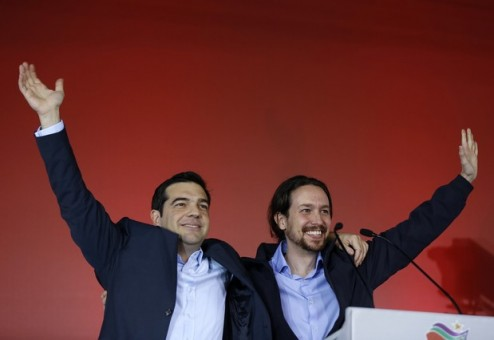 Greek head of Syriza party, Tsipras and Podemos party Secretary General Iglesias wave to supporters following a campaign rally in central Athen