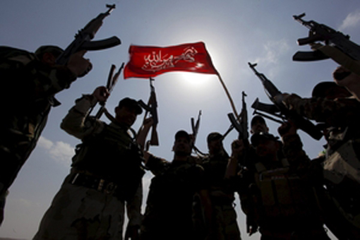 Hashid Shaabi forces allied with Iraqi forces chant slogans against the Islamic State in Tikrit