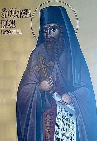 Sfântul Ioan Iacob cel Nou (Hozevitul) este unul dintre cei mai recenți sfinți din Biserica Ortodoxă Română, cu metania din Mănăstirea Neamț, care s-a nevoit 24 de ani în Ţara Sfântă, atât pe valea Iordanului, cât și în pustiul Hozeva, constituindu-se într-un model veritabil de viețuire în Hristos în era contemporană. Biserica l-a rânduit ca pildă vie de credință și de viețuire creștinească, înscriindu-l în calendarul ortodox la data de 5 august - foto: ro.orthodoxwiki.org