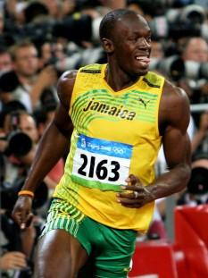 Usain Bolt (n. 21 august 1986, Sherwood Content, Jamaica) atlet jamaican, sprinter, recordman mondial la proba de 100 m, cu timpul 9,58 secunde - foto - ro.wikipedia.org