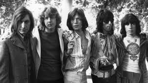 The Rolling Stones este o trupă englezească de muzică rock care a devenit populară la începutul anilor 1960. Trupa a fost formată la Londra în 1962 de Brian Jones, Mick Jagger și Keith Richards. The Rolling Stones a lansat 55 de albume și compilații și au avut 37 de piese în top-10 singles. În 1989 trupa a intrat în Rock and Roll Hall of Fame iar în 2004, revista Rolling Stone i-a clasat pe locul 4 în 100 Greatest Artists of All Time. Au vândut peste 200 de milioane de albume în întreaga lume - foto (British rock band the Rolling Stones after the death of founder member Brian Jones, in 1969): rollingstone.com
