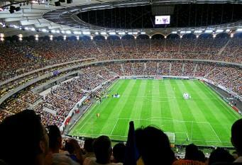 Arena Națională, cunoscută printre localnici și ca Stadionul Național, este un stadion de fotbal din București, România, pe care se dispută meciurile echipei naționale de fotbal,meciurile echipei Steaua,finala Cupei României și meciul din Supercupa României. Cu o capacitate de 55.600 de spectatori, este cel mai mare stadion din țară[8] și primul stadion de elită UEFA din România, succedat de Cluj Arena. Construcția arenei al cărei proprietar este Primăria Municipiului București a fost finalizată în 2011, având un cost total de aproximativ 234 mil. €. - foto (Arena Națională la meciul de deschidere, România vs. Franța, scor 0-0, 6 septembrie 2011):  ro.wikipedia.org