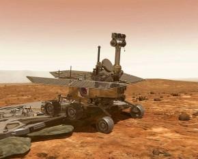 """Vehiculul spațial Spirit, denumit oficial Mars Exploration Rover - A sau MER-A, este primul dintre cele două vehicule spațiale de tip """"rover"""" ale misiunii Mars Exploration Rover a organizației NASA. """"Rover"""" e un cuvânt englez cu traducerea """"vagabond"""" și care aici se referă la un automobil pentru teren accidentat. A amartizat cu succes la ora 04:35 UTC în ziua de 4 ianuarie 2004 - in imagine - Desen artistic al unui rover pe Marte - foto: ro.wikipedia.org"""