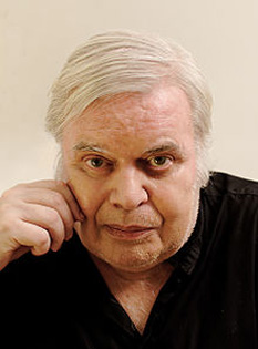 "Hans Rudolf ""Ruedi"" Giger (/ˈɡiːɡər/ ghee-gur; German: [ˈɡiːɡər]; 5 February 1940 – 12 May 2014) was a Swiss surrealist painter, whose style was adapted for many media, including record-albums, furniture and tattoo-art - in imagine, Hansruedi Giger, photographed in July 2012 - foto; en.wikipedia.org"