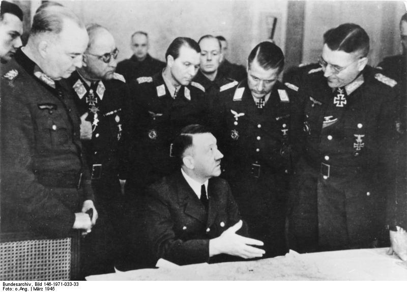 Generaloberst Theodor Busse (standing, far right) in a meeting with Adolf Hitler, March 1945 - foto: en.wikipedia.org