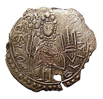 Vladimir the Great (c. 958 – 15 July 1015) - Vladimir's effigy on one of his coins. He is crowned in the Byzantine style, holding a cross-mounted staff in one hand and holding a Khazar-inspired trident in the other - foto preluat de pe en.wikipedia.org