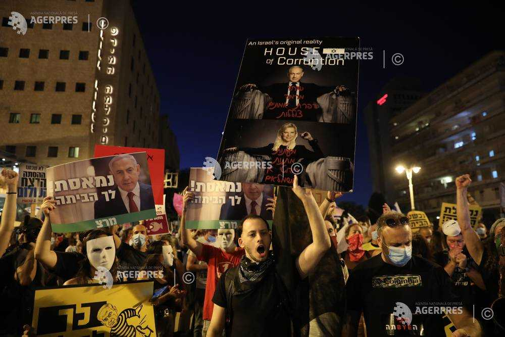 Israel: Protestatarii cer demisia lui Netanyahu, acuzându-l de corupţie şi gestionarea necorespunzătoare a crizei coronavirusului (8 august 2020) - Foto: (c)  ABIR SULTAN/ EPA, preluat de pe www.agerpres.ro